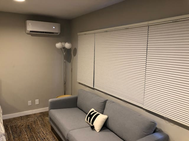 Interior couch with blinds closed for privacy.