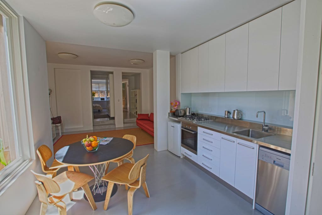 It has a modern kitchen and a light and airy living room.