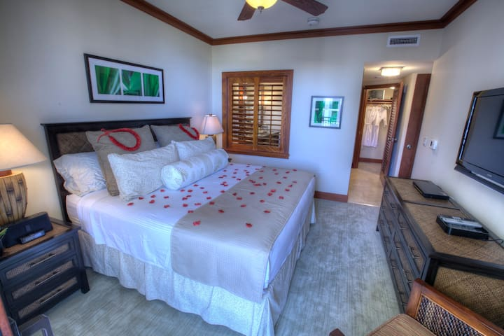 Master bedroom with king bed and ensuite bathroom.