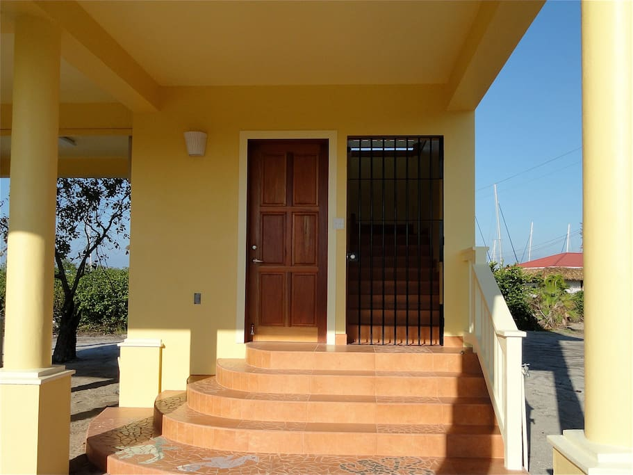The door on the left leads to the utility and storeroom. The one on the right is your gateway to Casa Edgell!
