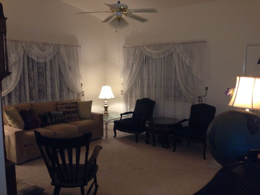 living room with couch that makes into queen  size bed