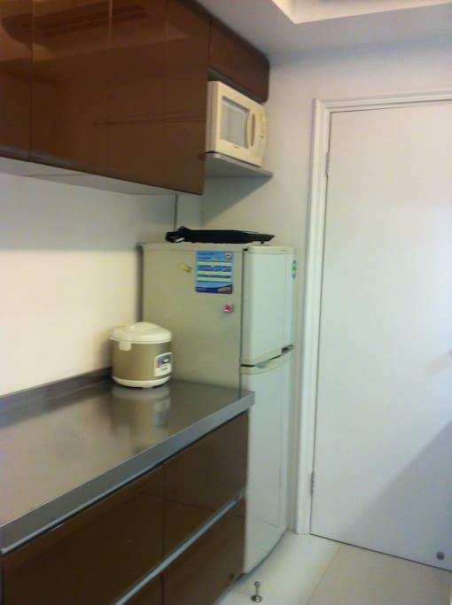 Open kitchen standard fridge and cooking equipment