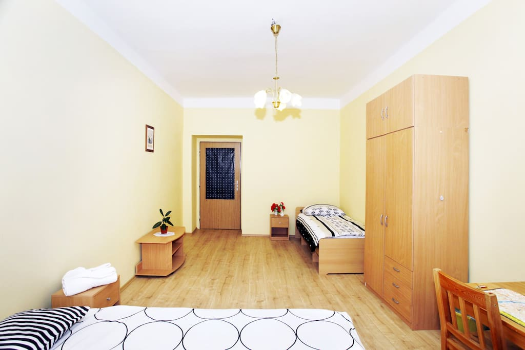 Furniture includes a double bed, large table, wardrobe, single bed, night tables and a small table.  It's a lot of space.