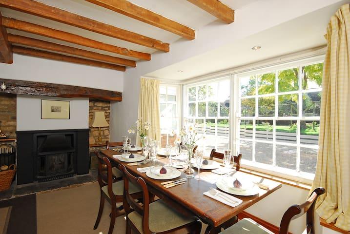 dining room with log burner