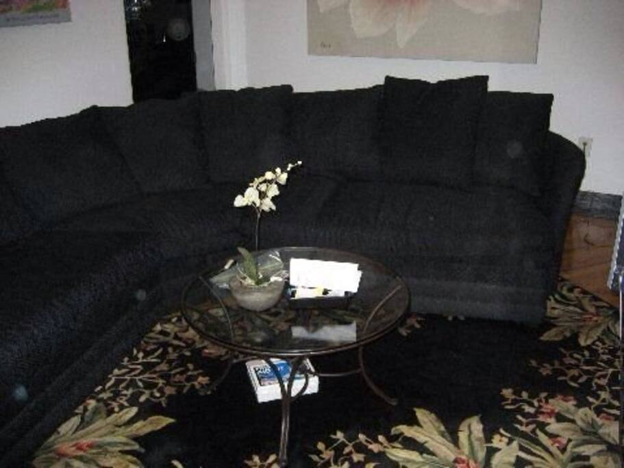Large living room with sectional for relaxing after a long day of touring.