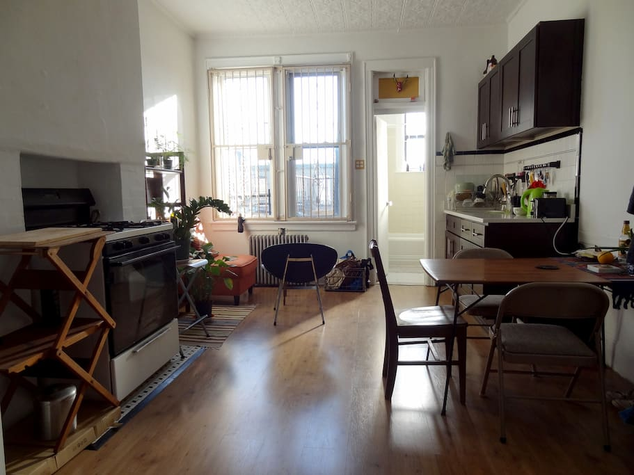 Kitchen, sitting corner and door to bathroom