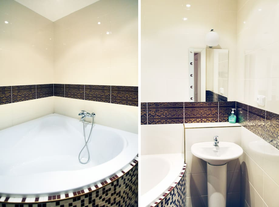 The bathroom with big corner bathtub