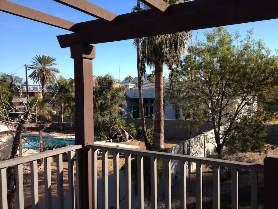 from private entry balcony looking southeast toward neighboring yard
