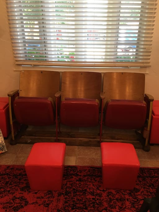 Here's a close-up of the vintage high school auditorium seats in the living room. (They're comfortable, too!)
