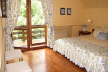 Yellow bedroom faces North - cozy in winter, cool even during the hot summer: a large double bed, own bathroom and a balcony with the fantastic view over the mountains and the Pikuj peak