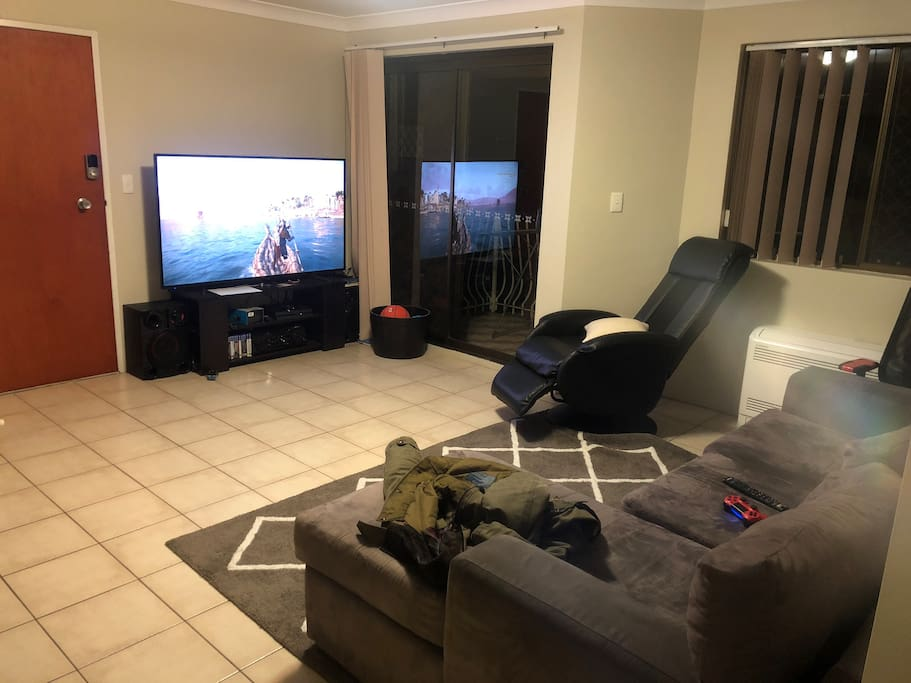 Living Room with 65' TV, Netflix and Playstation 4