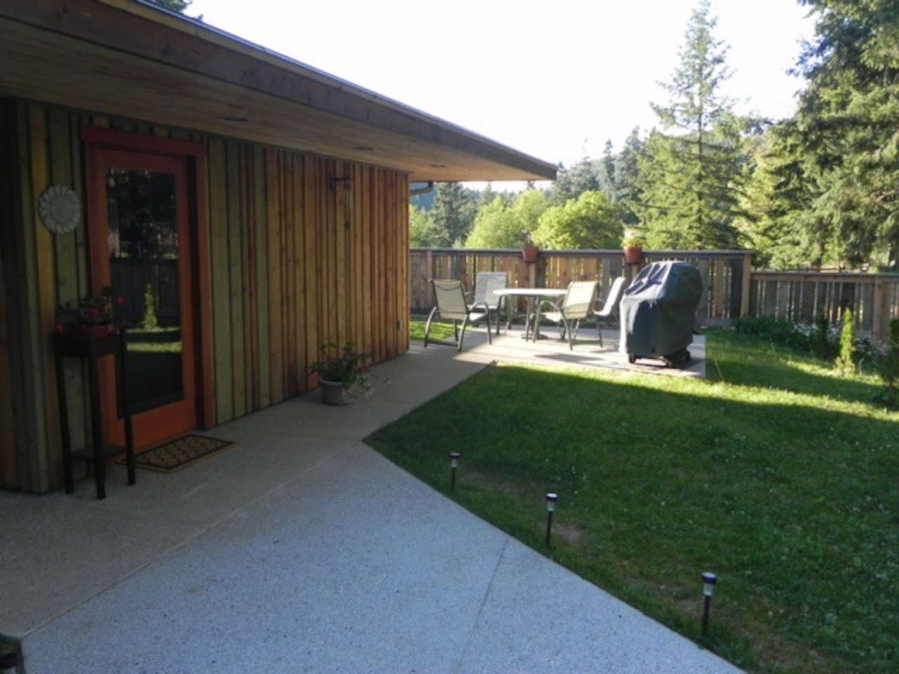 Private garden with BBQ, patio table & chairs.