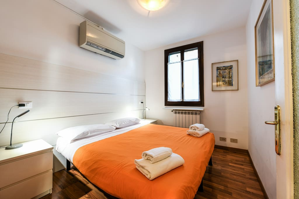 The first bedroom, with double bed and air conditioning.