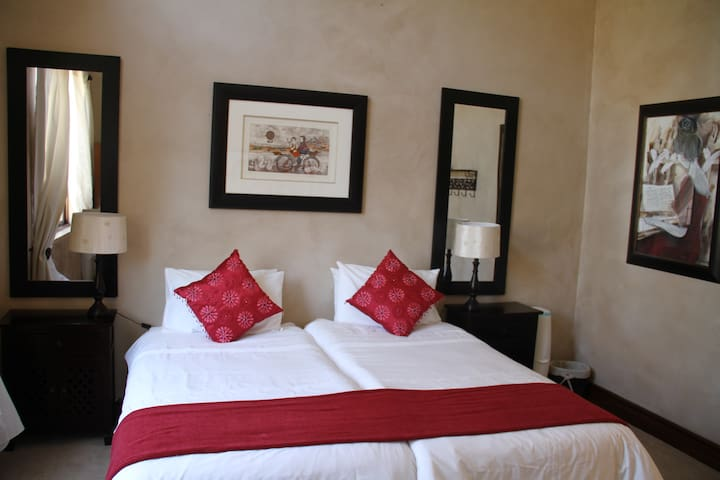 The Red Room - Two single beds - ideal for the kids with a shower next door