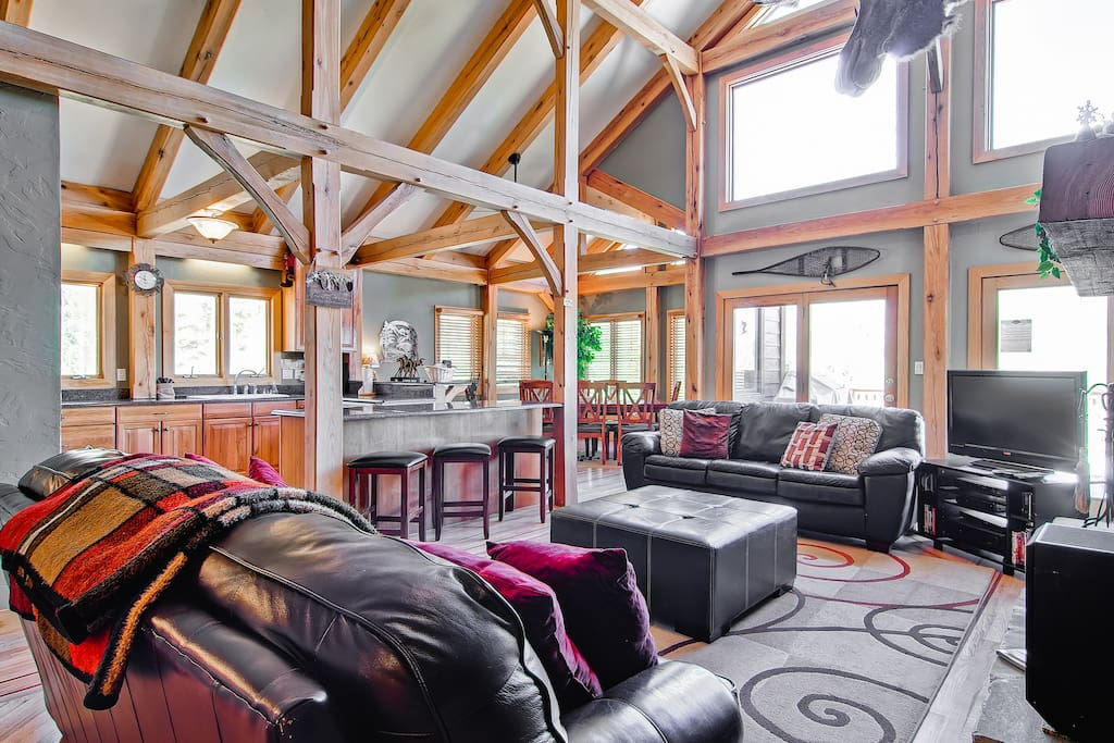 The open layout, wall of windows, and vaulted ceiling make this an inviting place to hang out.