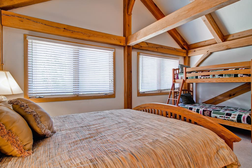 The upstairs master bedroom #2 has queen bed, and twin bunk, TV, and private bath.