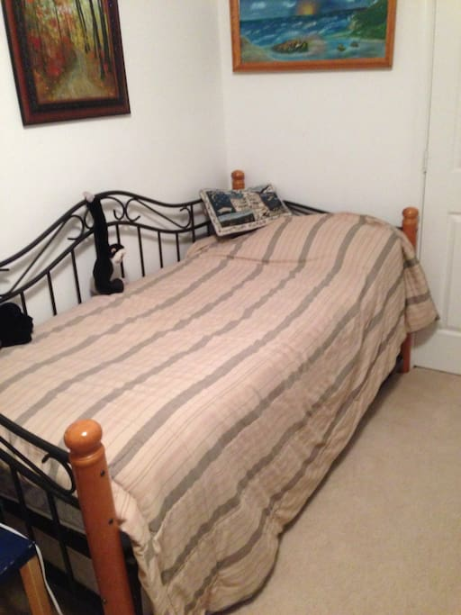 Bedroom upstairs with three single beds, bed two