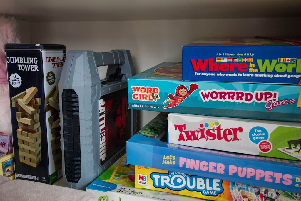 Shelving unit has lots of books, puzzles and board games to keep you entertained while at home.