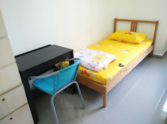Solid single bed with a comfortable 6-inch spring mattress, a clean mattress protector, a clean bed sheet, a clean warm blanket and a clean comfortable pillow. Plus a desk, a chair and a wardrobe with 2 clothes compartments and 8 drawers with locks.