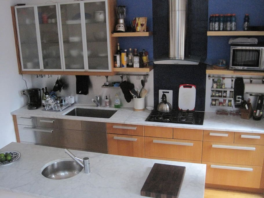 Massive fully equipped chef's kitchen with marble countertops