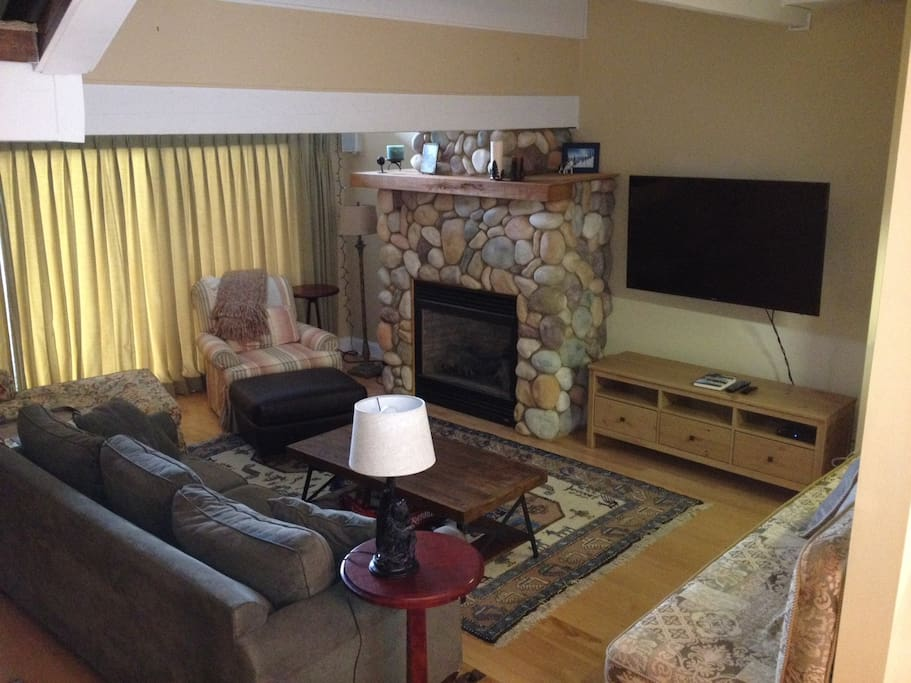 Roomy living room with cozy gas fireplace