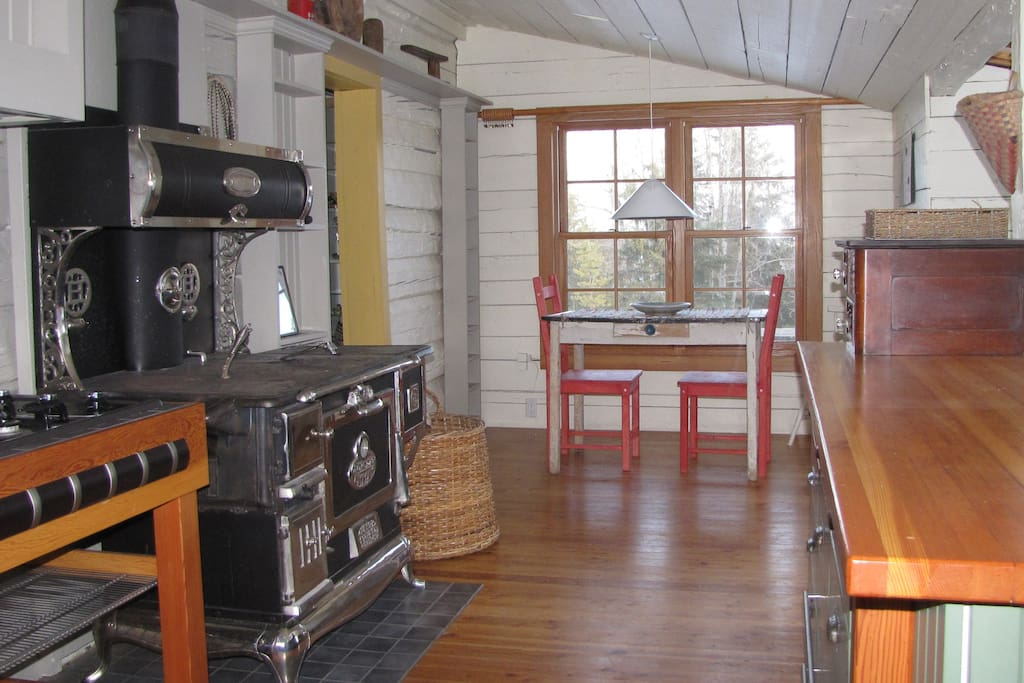 The heritage character of the home is carried through to the kitchen.  A restored 1907 wood cookstove sits beside a modern gas range.  Enjoy your meals at the breakfast bar and kitchen table with gorgeous views of the surrounding countryside.