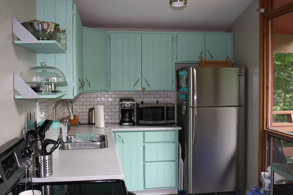 Updated kitchen with brand new Stainless Steel appliances, new countertop and vibrant cupboards.