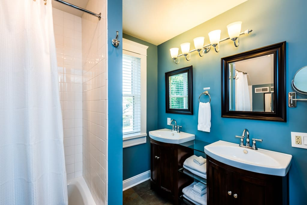Your own attached private ensuite bath with heated tile floor, dual vanities, generous soaking tub/sower, hair dryer, shampoo, conditioner, soaps and hand-loomed bath mat.