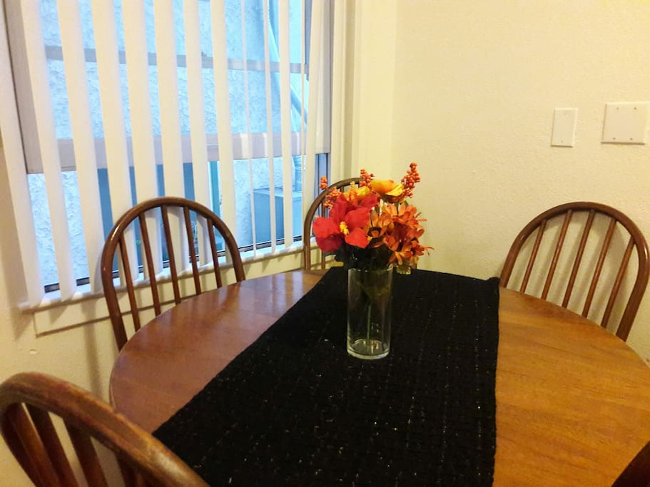Small dining area next to the kitchen. Open up the window for a nice breeze!