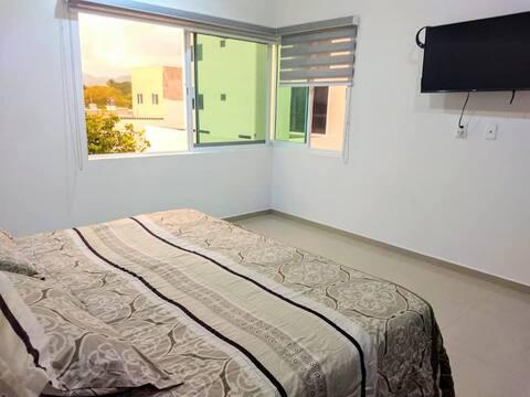 Amplia y comoda habitacion con baño privado