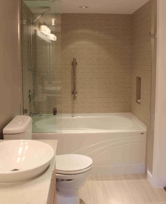 Full Size Soaker Tub, Vessel Sink w/ Plenty Of Cabinet Storage.