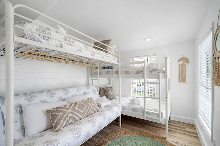 The bunk room has a twin-over-twin bunk and a twin-over-full futon.