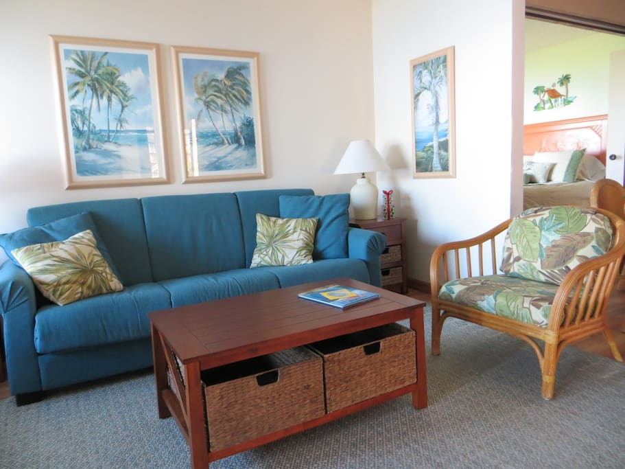 Living area with casual island decor and lanai access
