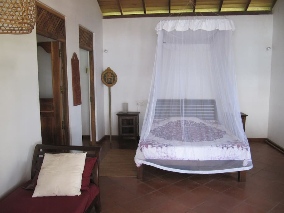 Master bedroom with mosquito net