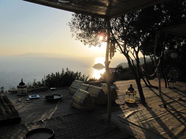wooden deck area- outdoor living area sun set