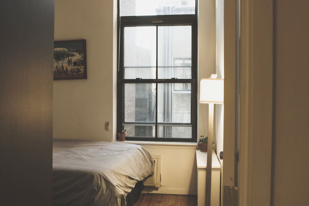 your bedroom, with a Tempur-pedic mattress and pillows, high ceilings and bright large windows