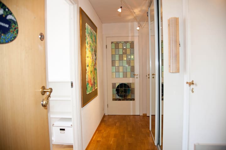 Entrance with wardrobe. Room for rent to the left.