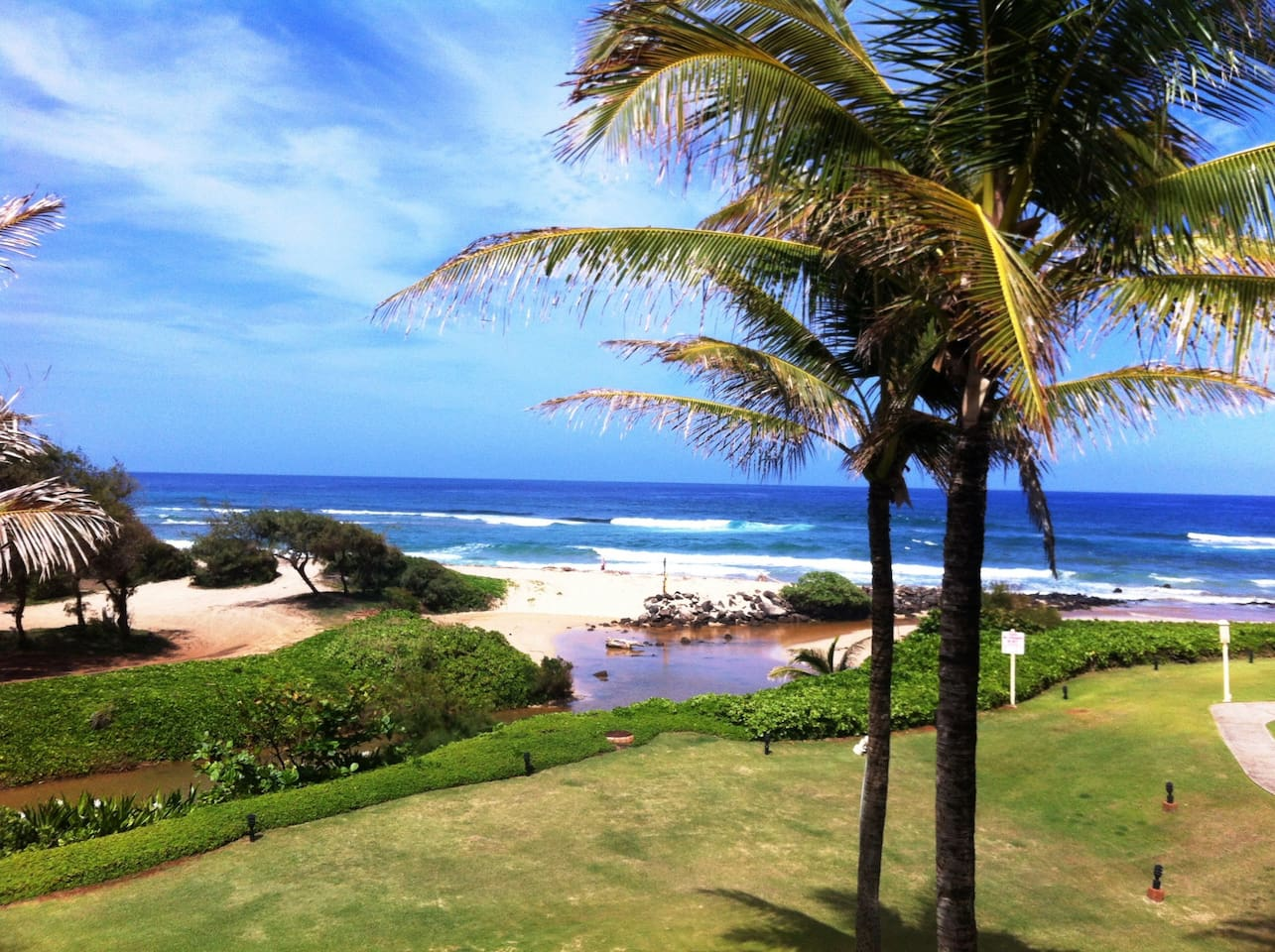 Hear and see ocean a few yards away from your living room, dining alcove and balcony lanai.
