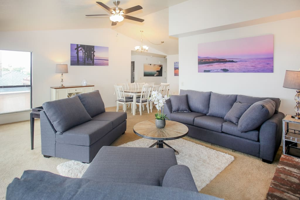 There is ample seating in the living room on a comfortable couch and loveseat.