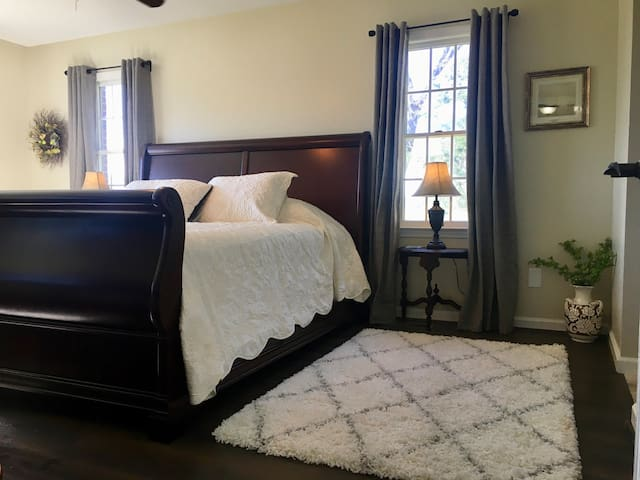 Master suite with king size quality mattress, luxury modal sateen sheets, natural cotton blankets, walk-in closet, and luggage cart. Beautiful views