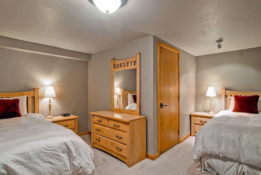 The downstairs #5 has a open doorway, but sleeps 2 comfortably on twin beds.