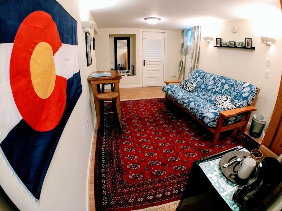 Our Colorado-themed guest suite living area featuring vintage post cards of local attractions and art by local artists.
