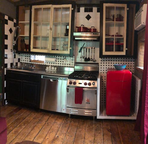 Kitchen with commercial Wolf stove.