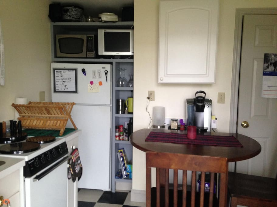 Kitchen includes stove top, oven, microwave and coffee maker