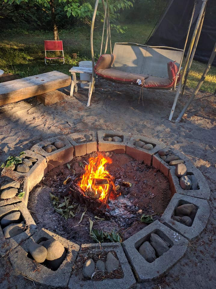 Main firepit. There is an additional fire area with a grill for cooking.