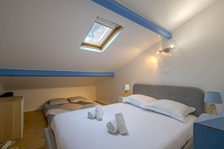 The cozy mezzanine bedroom