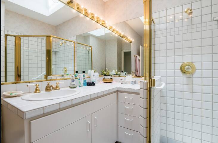 Lots of mirrors and light in our second bathroom and tons of counter space