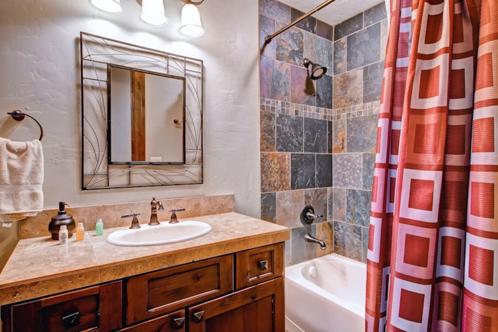 The downstairs shared bath has a tub/shower combo and serves bedroom #4 and bunk room.