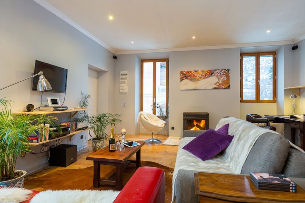 Comfy fireside living area with smart tv, surround sound, wifi, bluetooth sound and some great board games.