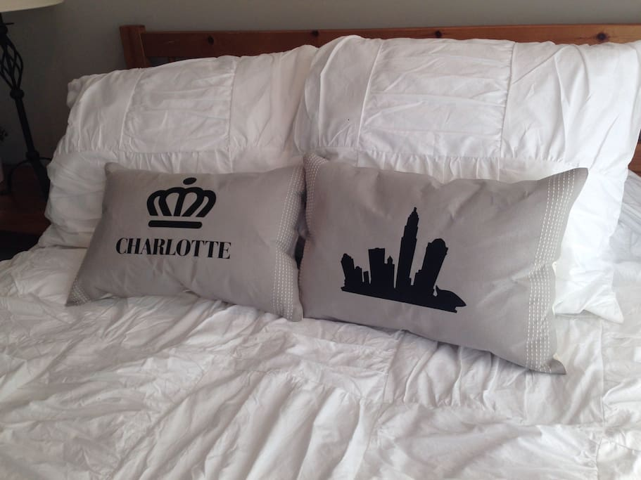 Comfortable memory foam bed with custom Charlotte pillows!